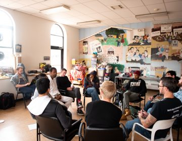 Participants in a masculinity workshop discuss a reading at Lutheran Settlement House on Sunday, October 28, 2018. (Kriston Jae Bethel for WHYY)