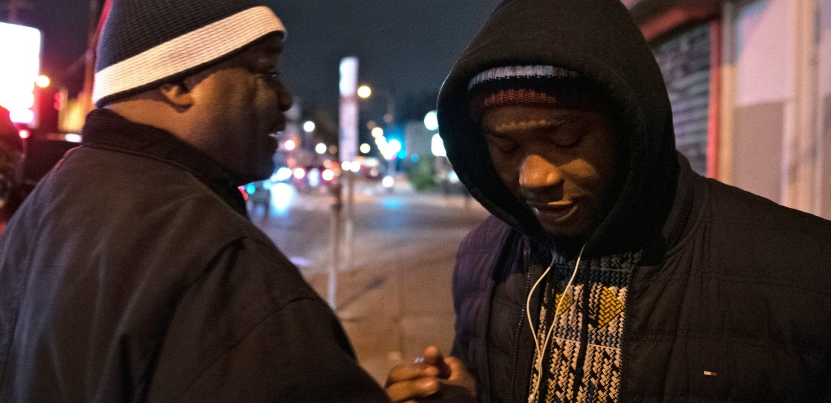 Shondell Revell says goodbye to Omar Smith, before he's given a ride home by CCIP members. (Kriston Jae Bethel for WHYY)