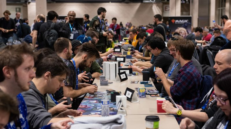 Competitors prepare their card decks during a Magic: The Gathering tournament at PAX Unplugged. (Kriston Jae Bethel for WHYY)