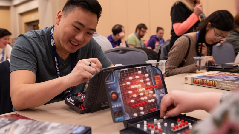 David Chang marks his board during a Battleship tournament at PAX Unplugged. (Kriston Jae Bethel for WHYY)