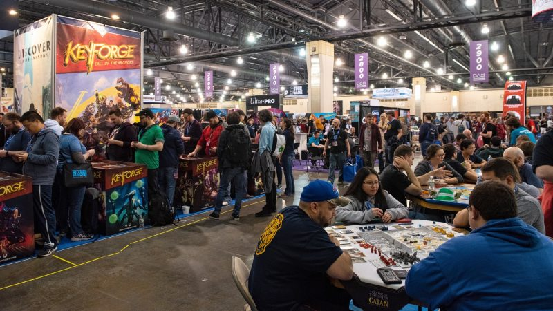 Convention goers at PAX Unplugged try out the latest games that vendors have set out for testing on the showroom floor. (Kriston Jae Bethel for WHYY)