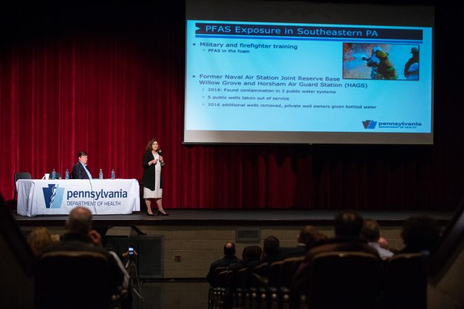 Dr. Christopher Reh, from the Agency for Toxic Substances and Disease Registry, and Dr. Sharon Watkins, from the Pennsylvania Department of Health, present the findings of an initial study on the prevalence of perfluoroalkyl and polyfluoroalkyl substances (PFAS) at Upper Dublin High School in Fort Washington, Pa. The study tested the blood of residents in Warrington, Warminster and Horsham areas, where the chemicals are believed to have entered the drinking water from local military bases. (Kriston Jae Bethel for WHYY)
