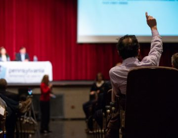 Gary Steinberg raises a hand to ask a question following a presentation by the Pennsylvania Department of Health on the findings of an initial study on the presence of chemicals found in local drinking water. (Kriston Jae Bethel for WHYY)