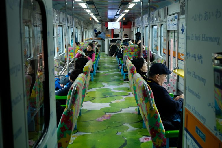 The interior of the DMZ train, a three-car tourist train. It is decorated with words such as