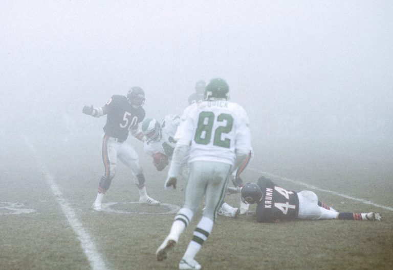 Philadelphia Eagles wide receiver Mike Quick (82) on the field in the thick fog during the NFC Divisional Playoff, a 20-12 loss to the Chicago Bears on Dec. 31, 1988, at Soldier Field in Chicago. 1988  (AP Photo/NFL Photos)