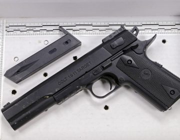 In this Nov. 26, 2014, file photo, a fake handgun resembling a Colt 1911 pistol, taken from Tamir Rice after he was fatally shot by Cleveland police, is displayed after a news conference in Cleveland. (Mark Duncan/AP Photo, File)