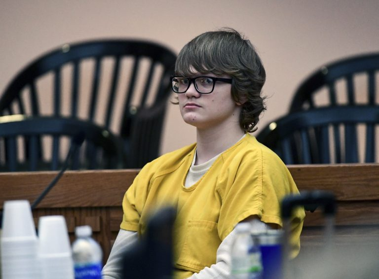 Jesse Osborne waits for a ruling at the Anderson County Courthouse on Friday, Feb. 16, 2018. Osborne, a boy who was 14 when he was charged in the shooting death of his father at their home and a first-grader on a South Carolina elementary school playground will be tried as an adult, a judge ruled Friday. (Ken Ruinard/The Independent-Mail via AP, Pool)