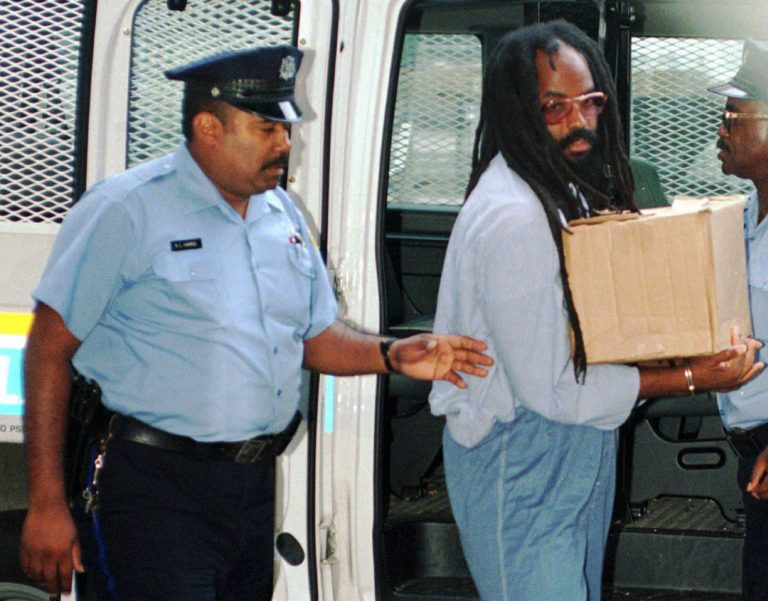 In this July 25, 1995 file photo, Mumia Abu-Jamal, convicted of killing a policeman, arrives at Philadelphia's City Hall.  (Nanine Hartzenbusch/AP Photo, File)