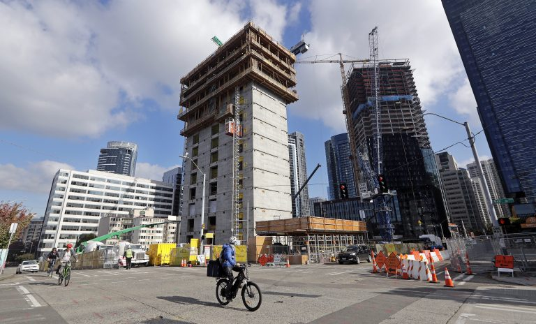 In this photo taken Wednesday, Oct. 10, 2018, construction goes on at the site of a new Amazon building, where space will be provided for a Mary's Place Family Shelter, in downtown Seattle. Amazon.com boss Jeff Bezos' plan to fund preschools in poor communities puts him in the company of America's richest people who have dedicated some of their wealth to education, a legacy that has long challenged the role of poverty and capitalism in philanthropy. (Elaine Thompson/AP)