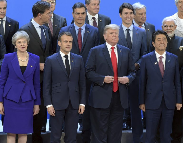 Working visit of Russian President Vladimir Putin to Buenos Aires. G20 Summit. From left to right in the front row: British Prime Minister Theresa May, French President Emmanuel Macron, US President Donald Trump and Japanese Prime Minister Shinzo Abe at the ceremony of joint photographing of all G20 participants. November 30, 2018. Argentina, Buenos Aires. (Photo by Dmitry Azarov/Kommersant/Sipa USA)(Sipa via AP Images)