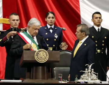 Mexico's new President Andres Manuel Lopez Obrador, (left), receives the presidential sash as Porfirio Munoz Ledo, president of the Congress, (right), looks on during the inaugural ceremony at the National Congress in Mexico City, Saturday, Dec. 1, 2018. (Eduardo Verdugo/AP Photo)