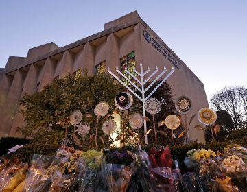 A menorah is installed outside the Tree of Life Synagogue in preparation for a celebration service at sundown on the first night of Hanukkah, Sunday, Dec. 2, 2018 in the Squirrel Hill neighborhood of Pittsburgh. A gunman shot and killed 11 people while they worshipped Saturday, Oct. 27, 2018 at the temple. (Gene J. Puskar/AP Photo)