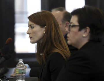 Katie Brennan, (left), the chief of staff at the New Jersey Housing and Mortgage Finance Agency, listens to a question as she testifies before the Select Oversight Committee at the Statehouse, Tuesday, Dec. 4, 2018, in Trenton, N.J. Brennan, a top staffer at the state's housing agency came forward as sexual assault victim and has said too little was done about her complaints, which she reported to law enforcement. (Mel Evans/AP Photo)