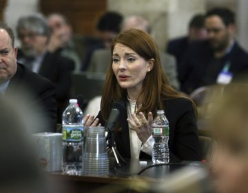 Katie Brennan, the chief of staff at the New Jersey Housing and Mortgage Finance Agency, answers a question as she testifies before the Select Oversight Committee at the Statehouse, Tuesday, Dec. 4, 2018, in Trenton, N.J. Brennan says Democratic Gov. Phil Murphy's campaign staff didn't take her sexual assault allegations seriously. (Mel Evans/AP Photo)