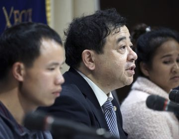 In this Nov. 28, 2018, photo, lawyer Shoichi Ibusuki, (center), attends a press conference on the problems in Japan's technical intern program, with Eng Pisey, (right), Cambodian technical intern and Huang Shihu, left, Chinese technical intern in Tokyo. Ibusuki, lawyer specializing in labor cases and supporting victimized foreign students and interns, called the internship program as a disguise to use trainees as mere cheap labor and should be scrapped and replaced with the new program underway. Japan is set to approve legislation that would officially open the door to foreign workers to do unskilled jobs and possibly eventually become citizens. (Eugene Hoshiko/AP Photo)