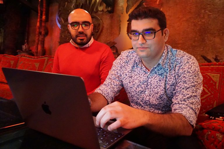 Certfa researchers Nariman Gharib, (left), and Amin Sabeti look at a computer at a cafe in London on Friday, Dec. 7, 2018. The Associated Press drew on data gathered by the London-based cybersecurity group Certfa to track how a hacking group often nicknamed Charming Kitten spent the past month trying to break into the private emails of more than a dozen U.S. Treasury officials. Also on the hackers' hit list: high-profile defenders, detractors and enforcers of the nuclear deal struck between Washington and Tehran, as well as Arab atomic scientists, Iranian civil society figures and D.C. think tank employees. (Raphael Satter/AP Photo)