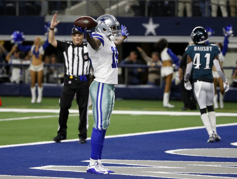 Dallas Cowboys wide receiver Amari Cooper (19) celebrates after a 75-yard touchdown catch against the Philadelphia Eagles during the second half of an NFL football game, in Arlington, Texas, Sunday, Dec. 9, 2018. (AP Photo/Ron Jenkins)