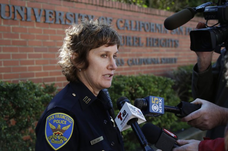 San Francisco Police Capt. Michelle Jean speaks to reporters in San Francisco, Thursday, Dec. 13, 2018. Authorities say bomb threats sent to dozens of schools, universities and other locations across the U.S. appear to be a hoax. (AP Photo/Jeff Chiu)