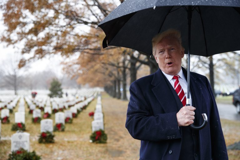 President Donald Trump speaks to media as he visits Section 60 at Arlington National Cemetery in Arlington, Va. on Dec. 15, during Wreaths Across America Day. (Carolyn Kaster/AP)
