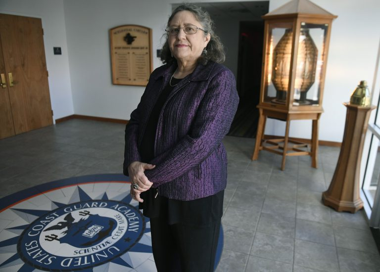 In this Tuesday, Dec. 18, 2018 photo, Michele Fitzpatrick, a retired lieutenant commander in the Coast Guard, poses for a photograph at the United States Coast Guard Academy in New London, Conn. Female veterans, both current and former service members, were more likely to vote in the 2018 midterm elections for Democrats than Republicans, 60 percent to 36 percent, according to data from VoteCast. (AP Photo/Jessica Hill)
