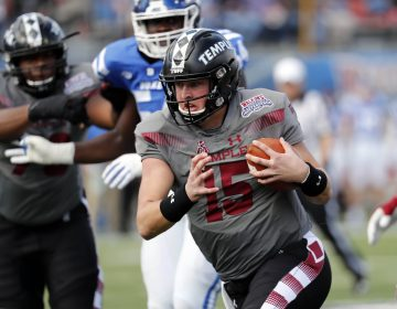 Temple quarterback Anthony Russo (15) runs for a short gain against Duke during the first half of the Independence Bowl, an NCAA college football game, in Shreveport, Louisiana, Thursday. (AP Photo/Rogelio V. Solis)