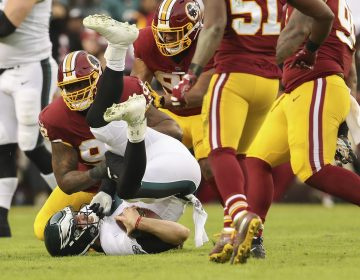 Washington Redskins defensive tackle Stacy McGee (92) sacks Philadelphia Eagles quarterback Nick Foles (9) during the first half of the NFL football game, Sunday, Dec. 30, 2018 in Landover, Md. (Andrew Harnik/AP)