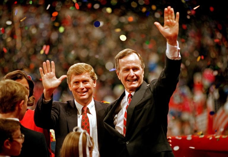 FILE - In this Aug. 18, 1988 file photo, Republican presidential candidate, Vice President George H.W. Bush,  right, and his running mate Sen. Dan Quayle, R-Ind., wave to the assembly of the Republican National Convention in New Orleans after their acceptance speeches for the presidential and vice-presidential nomination.  (AP Photo/J. Scott Applewhite, File)