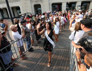 Miss America contestants wave during the traditional Miss America welcoming ceremony on the Atlantic City, N.J., Boardwalk on Tuesday, Sept. 1, 2015.  (Edward Lea/The Press of Atlantic City via AP)