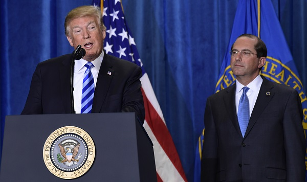 President Donald Trump, stands with Health and Human Services Secretary Alex Azar, and talks about drug prices during a visit to the Department of Health and Human Services in Washington, Thursday, Oct. 25, 2018. (Susan Walsh/AP Photo)