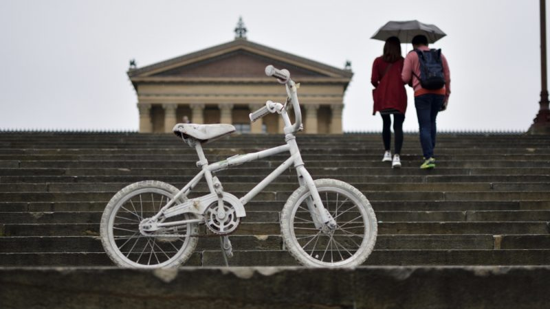 A white-painted ghost bike is parked on the Philadelphia Art Museum steps, ahead of the Ride of Silence on Wednesday, May 16, 2018. The annual event is held to remember recent bicycle deaths in the city. (Bastiaan Slabbers for WHYY)