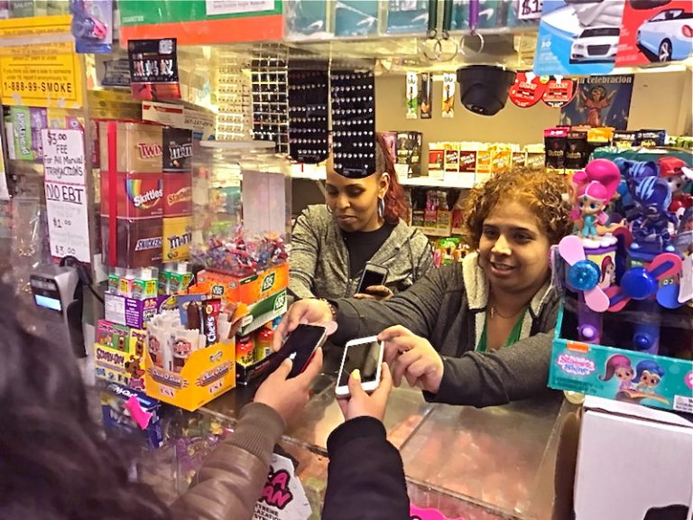 Employees at Nelvin Grocery hold phones for students free of charge. (Courtesy of Ronnie Polaneczky)