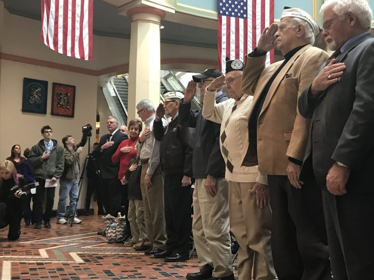 (From left) Hank Heim, William Bonelli, Richard Schimmel and Isaac George salute at a ceremony commemorating the Pearl Harbor attack. (Katie Meyer/WITF)