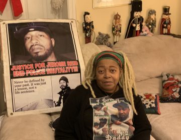 Sheila Reid, whose son, Jerame, was shot and killed by police in 2014, has urged Gov. Phil Murphy to sign a bill requiring New Jersey to investigate all police-involved deaths. She's sitting in front of a poster made to remember him, that spells his name the way it's pronounced. (Ang Santos for WHYY)