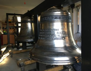 This 1,200 lb. bell, just slightly smaller than the Liberty Bell, sits inside Delaware Symphony Orchestra music director David Amado's garage in Greenville, Delaware. (Mark Eichmann/WHYY)