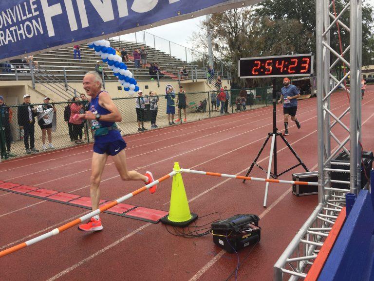 Gene Dykes crosses finish line in record time at Jacksonville Marathon (Courtesy Mark Grubb)