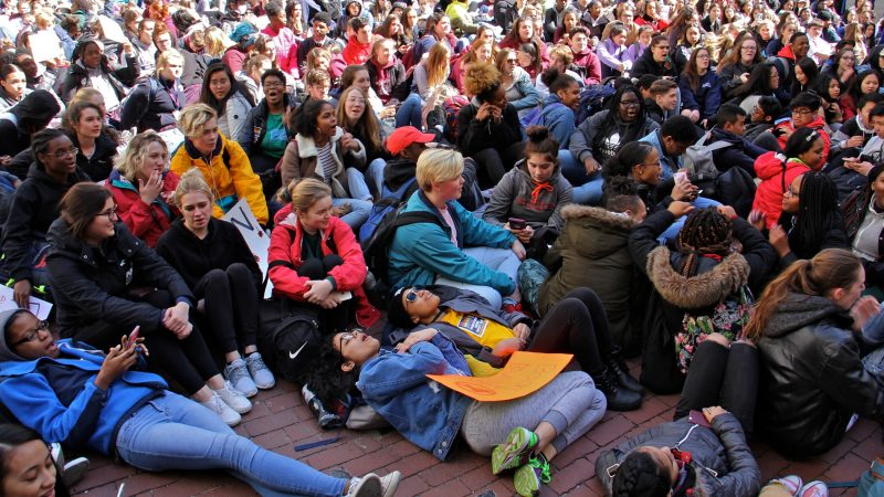 High school students lie down in the City Hall courtyard for a die-in, part of a national day of protest against gun violence on the 19th anniversary of the Columbine school shooting. An even deadlier school shooting in February in Parkland, Florida, brought increased attention to gun control issues. (Emma Lee/WHYY)