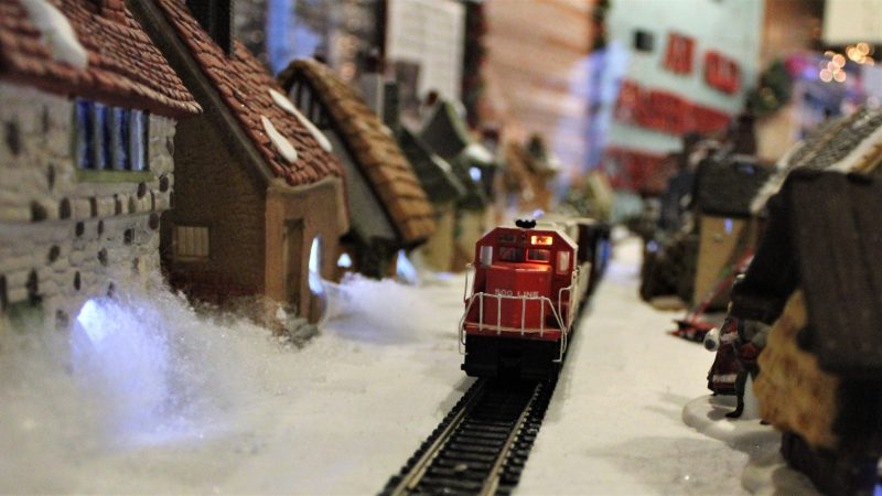 In a gallery in the Carriage House on the property of the Emlen Physick Estate on Lafayette Street, the Mid-Atlantic Center for the Arts and Humanities has a display on an old-fashioned Christmas, including an elaborate village and model train display. (Bill Barlow/for WHYY)