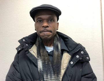 Robert Still, a former inmate living in Camden, owes about $2,000 in municipal court fines he says he is unable to afford. (Joe Hernandez/WHYY)