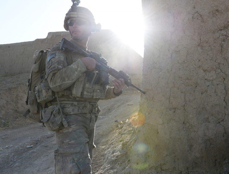 A soldier patrols a village in eastern Afghanistan. (Jad Sleiman/WHYY)