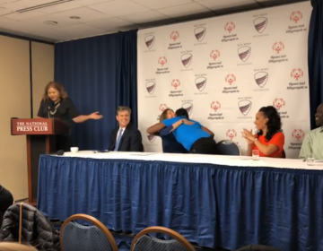 Special Olympics International chairman Tim Shriver sits with Beau Biden Foundation chair Hallie Biden at a press conference announcing a partnership to better protect athletes with intellectual disabilities from abuse. (Beau Biden Foundation/Youtube)