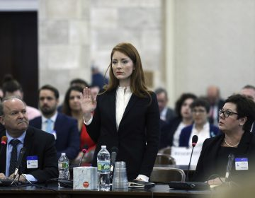In December 2018, Katie Brennan, the chief of staff at the New Jersey Housing and Mortgage Finance Agency, raises her hand as she is sworn in to testify before the Select Oversight Committee at the Statehouse in Trenton, N.J. (Mel Evans/AP Photo)