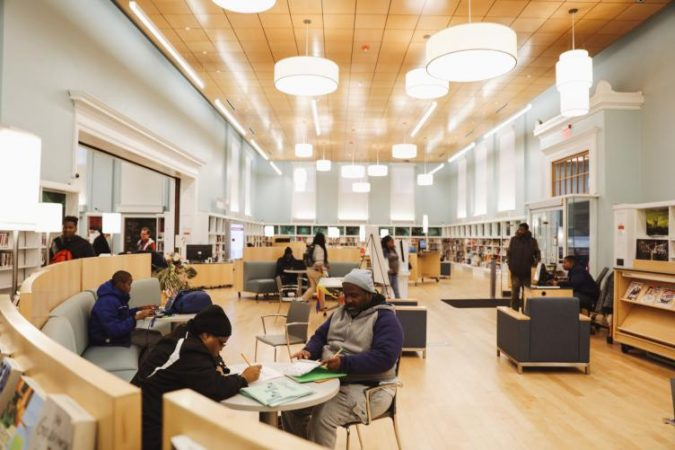 Logan Library's renovation opened up the double-height main room and now has casual, movable furniture (Neal Santos for PlanPhilly)