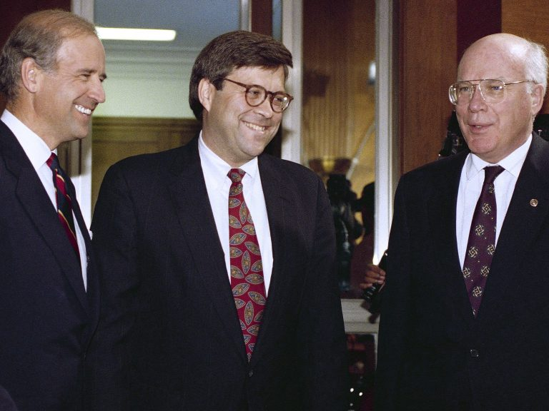 Attorney General nominee William Barr with then-Sen. Joe Biden, D-Del., chairman of the Senate Judiciary Committee, (left), and Sen. Patrick Leahy, D-Vt., before Barr's hearing on Nov. 12, 1991. (John Duricka/AP)