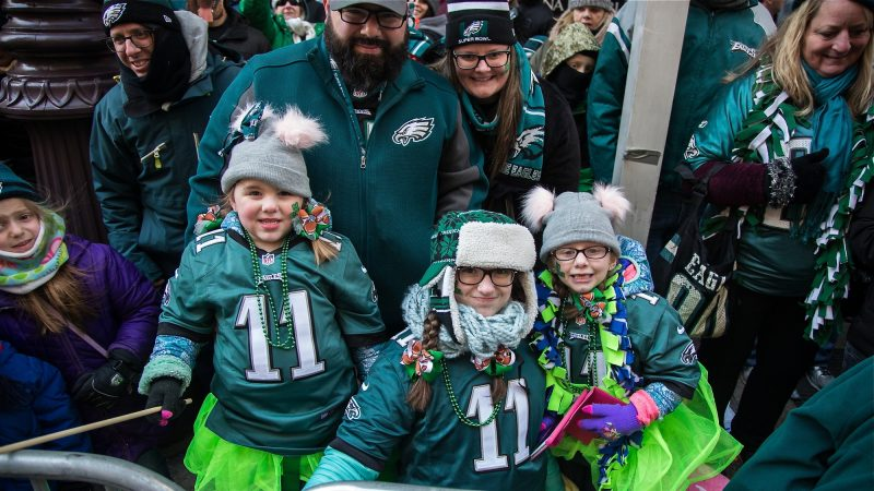 The Santora family stays warm and festive as they wait to cheer on their winning Eagles during the Super Bowl parade in Philadelphia Feb. 8, 2018. (Emily Cohen for WHYY)