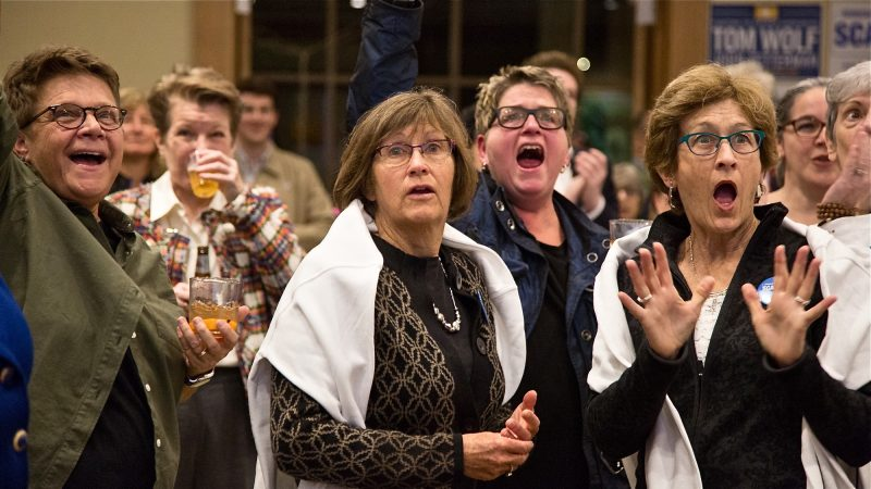 Frankie Franceschini, Linda McCarthy, Bonnie Shuman, and Sandy McCarthy (left to right) react as results come in for the 2018 midterm elections Nov. 6, 2018, in Swarthmore, Pennsylvania. (Emily Cohen for WHYY)