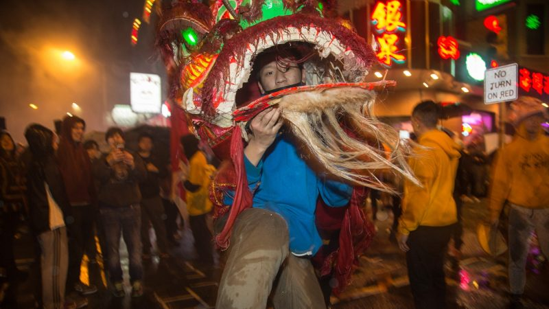 A member of the Philly Suns does a lion dance through the streets of Chinatown in celebration of the Chinese New Year on Feb. 15, 2018. (Emily Cohen for WHYY)