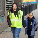 Dalia Burgos and her son Albert walk to Lewis Elkin School in Kensington. (Tom MacDonald/WHYY)