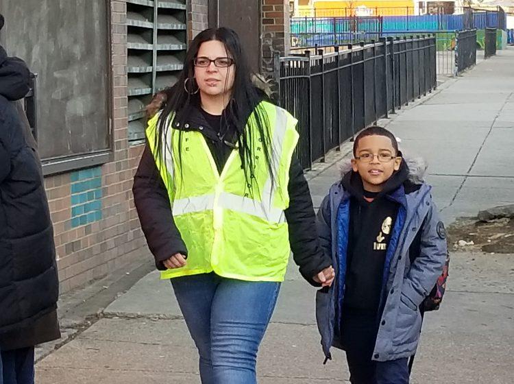 Dalia Burgos and her son Albert walk to Lewis Elkin School in Kensington. (Tom MacDonald/WHYY)
