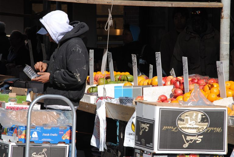 A fruit vendor in the Italian Market (David Swift Photography/ EOTS Flickr Group)