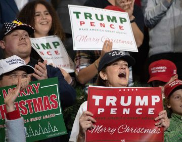 Supporters cheer as President Trump speaks during a rally in Mississippi in November. (Jim Watson/AFP/Getty Images)